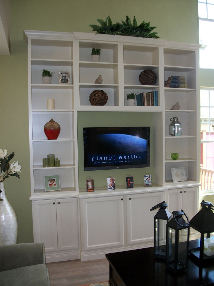 DIY tall entertainment center with stock cabinets and bookshelves