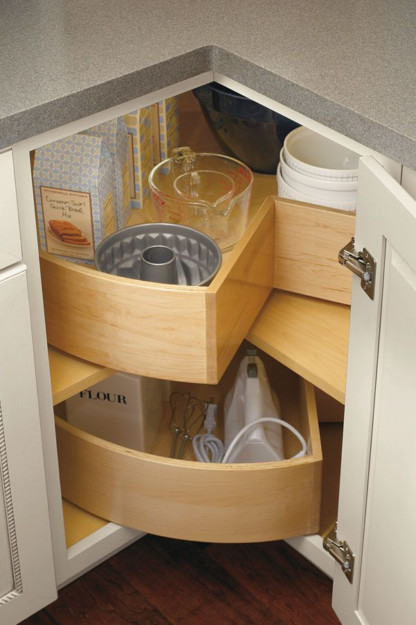 Deep bins keep taller items intact as they travel on a lazy susan cabinet, preventing spillage yet still maintain easy access.