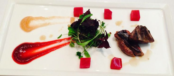 Pan fried breast of wood pigeon with beetroot puree, salt baked rainbow beetroot and baby herb salad