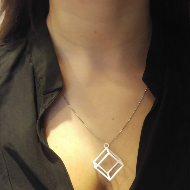 Cube Pendant    This cube necklace is the perfect fashion accesory for anyone who likes geometry.    Simple and sleek this simple mathmatical shape becomes an elegant pendant.