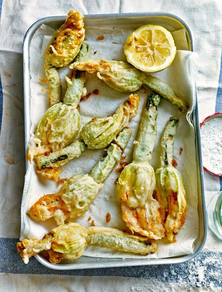 Once only a common sight in Italian food markets, courgette flowers are now widely available and this classic Italian dish from Michelin-starred chef Theo Randall makes the most of them. Deep-Fried Courgette Flowers Stuffed with Ricotta and Herbs make a stunning summer starter or light lunch - the perfect vegetarian dish to impress your guests.