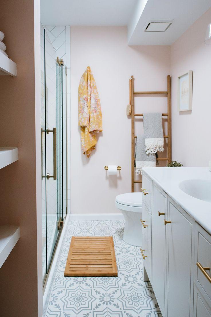 "Faucets: Kohler Purist Line. Vanity: Kohler Jacquard.  Mirror: West Elm ""Floating Wood Mirror"". Sconces: Crate & Barrel ""Lander Antique Sconce"" in Bronze. Floor Tile: Cement Tile Shop 'Leon I'. Wall Ladder: Home Decorators Collection. Robe: Plum Pretty Sugar.  Paint Color: Benjamin Moore 'Sugar Cane'"