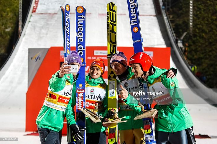Andreas Wellinger, Richard Freitag, Severin Freund and Andreas Wank from Germany make 'selfie' in front of photographers as they won the team competition during the FIS World Cup Ski Jumping day two on November 21, 2015 in Klingenthal, Germany.