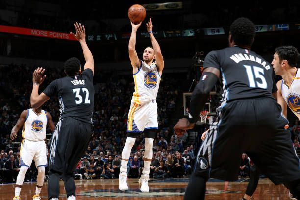 Stephen Curry of the Golden State Warriors shoots the ball during the game against the Minnesota Timberwolves on March 10 2017 at Target Center in...