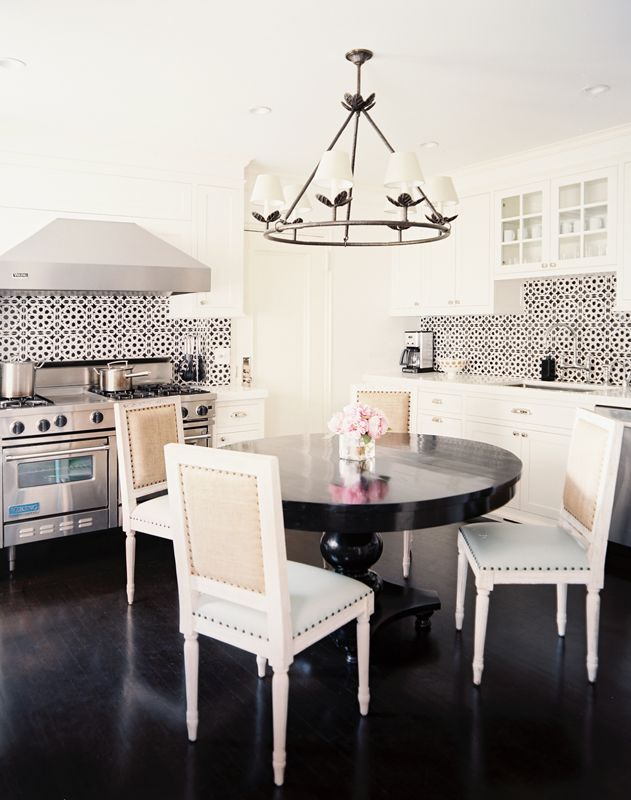 Morrocan-style tiles add a jolt of energy to this chic black & white kitchen: Dining Rooms, Backsplash Tile, Black And White, Chairs, Kitchens Tile, Kitchens Tables, Black White, Round Tables, White Kitchens