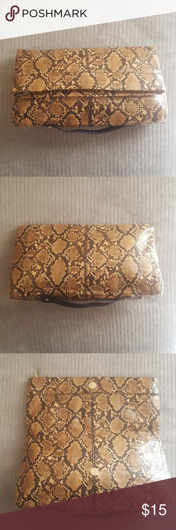Animal print fold over clutch BAG Has zipper closure and inside zip pocket. Gently use. Dimensions 13Lx8Hx3w Mango Bags Clutches & Wristlets