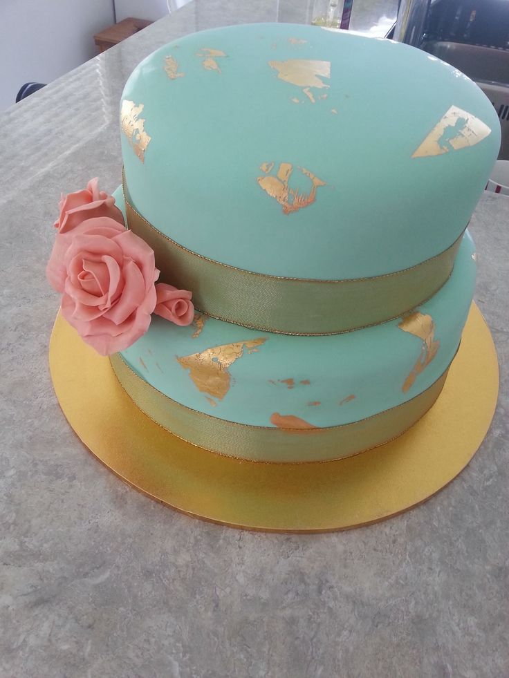 Gold leaf, coral and turquoise green 2 tier wedding cake