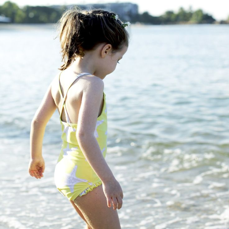 Beach belle Greta in our Starfish Swimsuit. Available at www.frolikbeachstyle.com in sizes 2-3, 4-5, 6-7 and 8-9yrs.