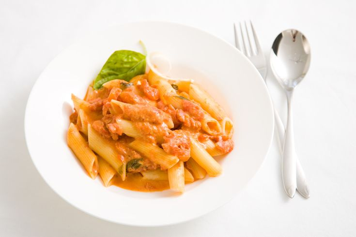 Penne with tomato cream. Oh gosh, this recipe is so lovely–And a little decadent. The perfect pairing of delicate cream and the tartness of beautiful San Marzano tomatoes. Easy to make, your family will love it. Perfect for a night in.