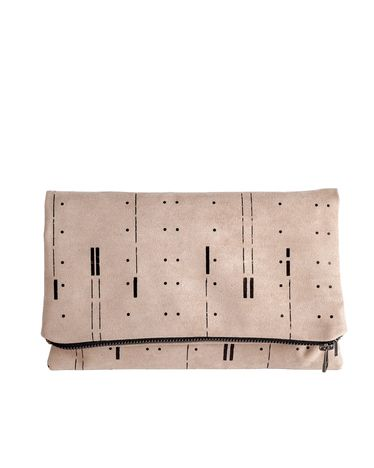 I love the beautiful delicate patterns on this suede fold over clutch