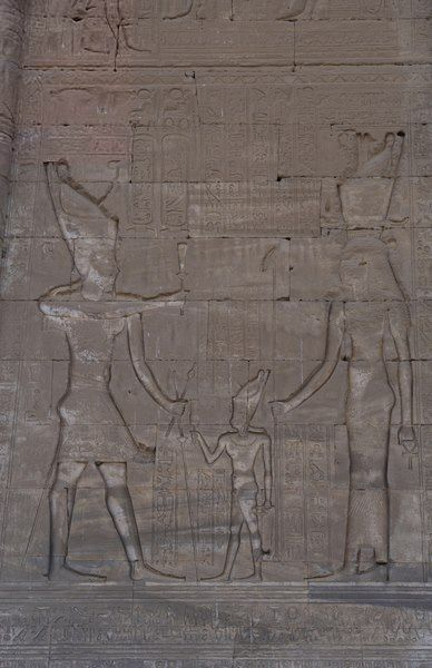 Relief depicting Cleopatra VII, Julius Caesar and their son Caesarion, later her co-regent Ptolemy XV Caesar. 1st Century BC, Ptolemaic Dynasty. Hathor Temple, Dendera.