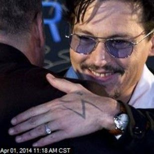 Latest News:  Johnny Depp Shows Off His Engagement Ring.  The rumors appear to be true: Johnny Depp really is off the market.  He showed up at a Beijing event yesterday promoting his new movie, Transcendence, wearing a diamond engagement ring.  Get all the latest news on your favorite celebs at www.CelebrityDazzle.com!