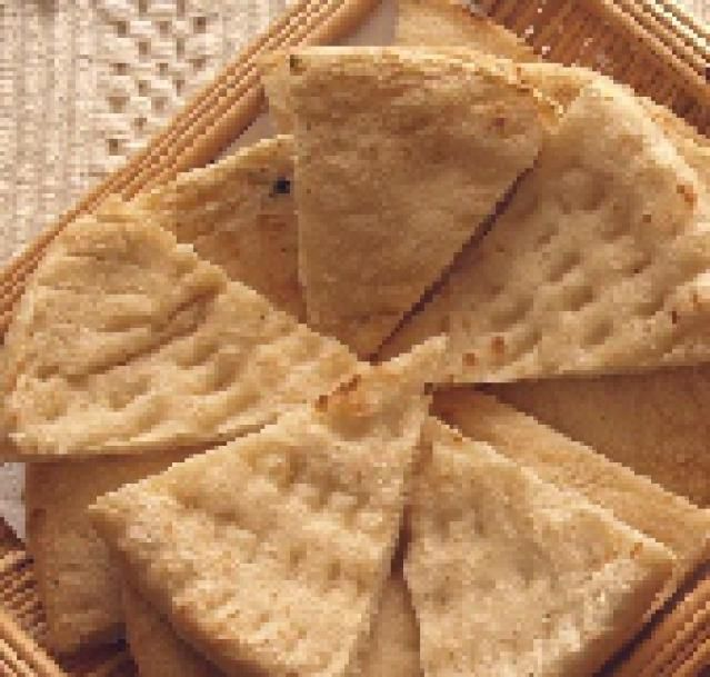 How to Make Homemade Pita Bread.    (I would add some white sesame seeds.)