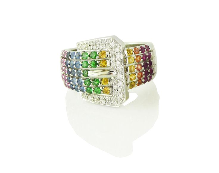 An 18ct White Gold, Rainbow Sapphire and Diamond Buckly Dress Ring