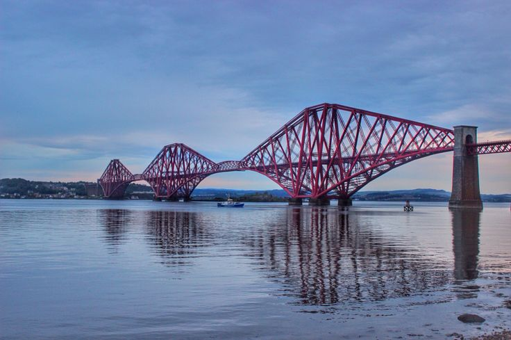 The amazing Forth Bridge seen from South Queensferry, built in 1882. A real engineering masterpiece for that time and one of the most famous landmarks in Scotland.