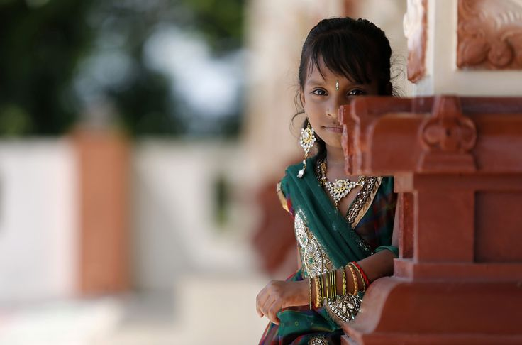 A girl at a temple after a prayer session during Diwali, the Hindu festival of lights