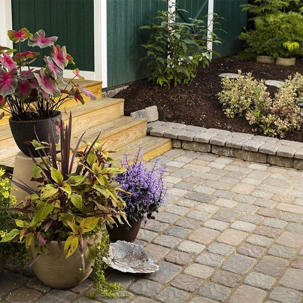 This spring, transform your landscape with pavers to create an inviting outdoor space. Click the link in profile for step-by-step instructions.  #lowes #landscape #pavers #walkway