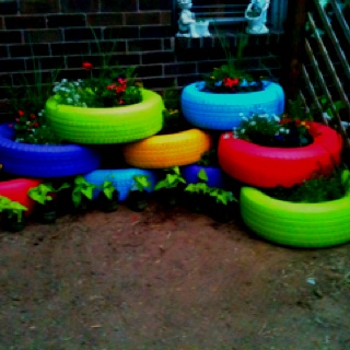 Painted tires plant bed and tire garden on pinterest - Painted tires for gardens ...