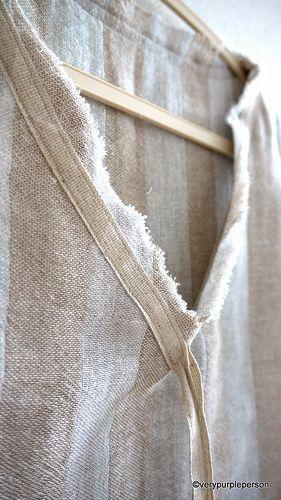 Linen tape at raw-edge V-neckline