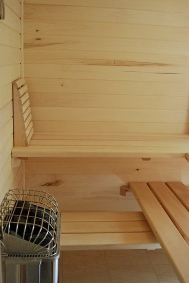 Small sauna for a small space, like the idea of sliding benches for cleaning/more room.