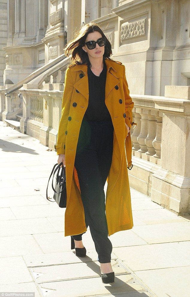 Cutting the mustard:Anne Hathaway proved why she is a darling of the fashion world as she stepped out in London on Sunday while happily stopping to pose with adoring fans