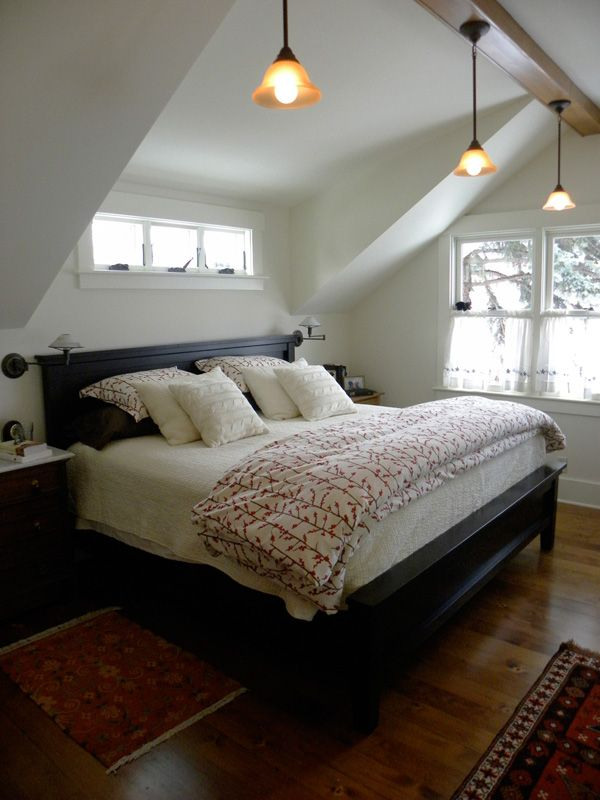 shed dormer inside bedroom, small windows above bed