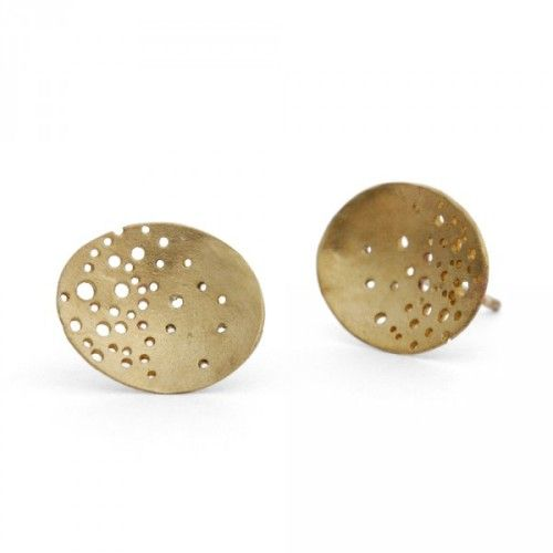Beautifully handmade 9 carat gold earring studs which look as though they had been handpicked by nature, they are oval-shaped with an organic drilled pattern than gradually becomes dense at the edge of the earring creating a delicate accent to the ear.