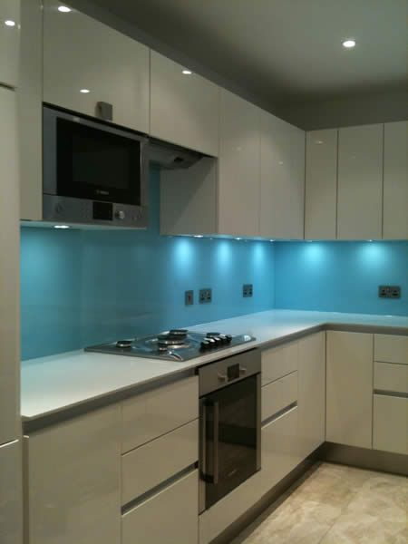 I love the glass as a reflective surface- Blue kitchen splashback