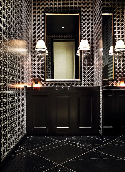 Great idea for a strong, masculine bathroom with black marble floors and vanity and intense geometric wallpaper in black and white, don't be afraid of … Read More
