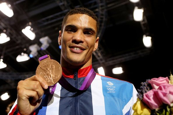 Bronze medalist Anthony Ogogo of Great Britain celebrates after the medal ceremony for the Men's Middle (75kg)