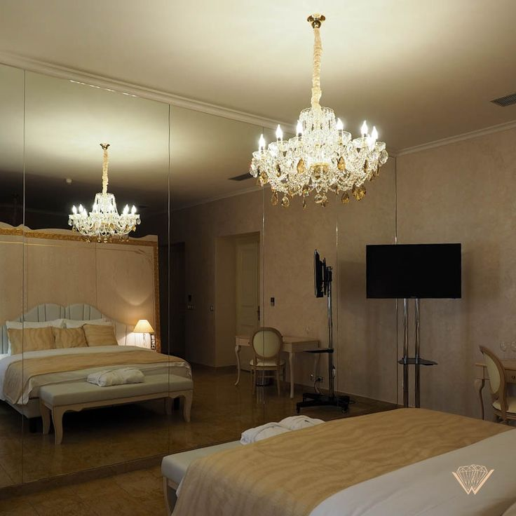 Our chandelier from Classe collection with gold honey trimmings in Myo Hotel Caruso in Prague.