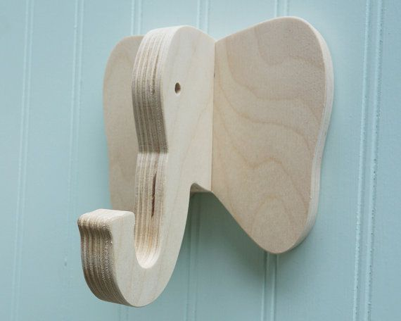 Although its perfectly fine to store your junk on its trunk, the elephant would much prefer to hold on to your more important possessions.  FREE SHIPPING in the USA!  Flat rate $10 USD shipping per order to Canada & Mexico.  Flat rate $16 USD shipping per order to the rest of the world.  Add some whimsical style to your home with the elephant wall hook. Created from European birch plywood, this hook will hold anything that any other hook will hold. But it will look like an elephant, which...