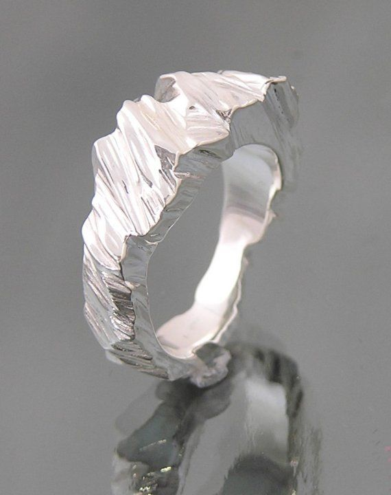 Janet Miller's rings which look like little silver glaciers.