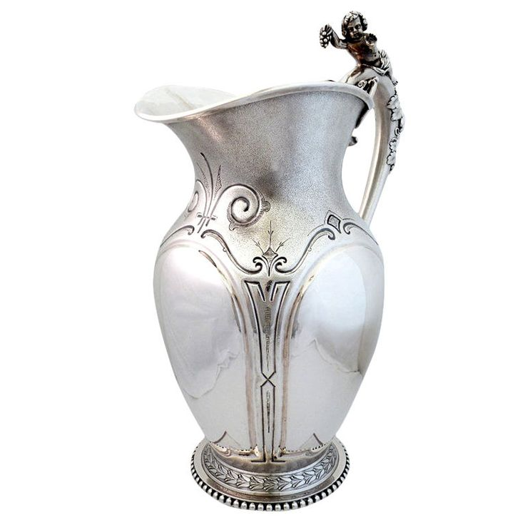 Wood & Hughes 1870 Sterling Silver Water Pitcher w/3-D Cherub  United States  1870