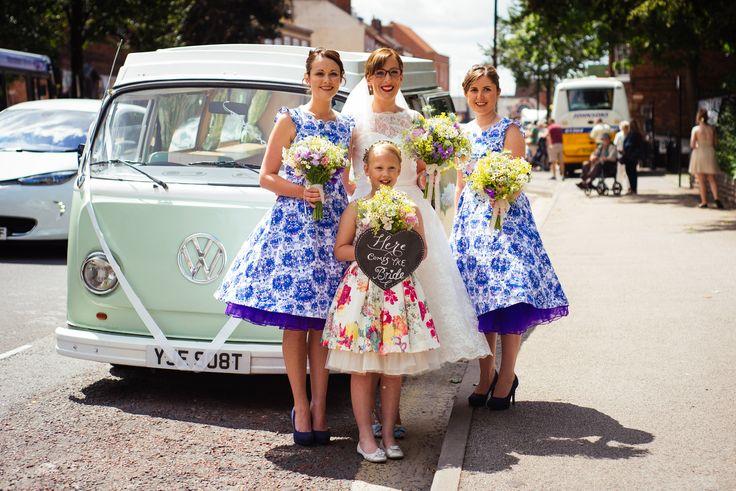 Beautiful bride and bridesmaids stood beside Betsy