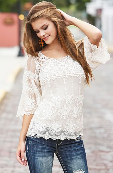 This lace on this shirt is beautiful! I am also a very big fan of pretty white shirts and jeans.