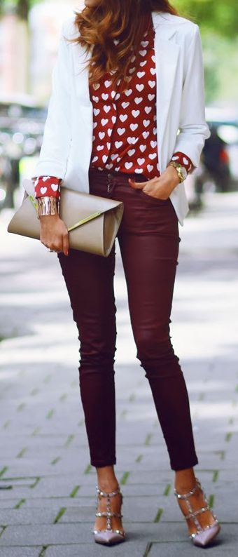 A nicely put together combination of a white blazer and burgundy slim jeans will set you apart effortlessly. Grey studded leather pumps will add a touch of polish to an otherwise low-key look.  Shop this look for $180:  http://lookastic.com/women/looks/blazer-button-down-blouse-watch-bracelet-clutch-skinny-jeans-pumps/7689  — White Blazer  — Red and White Print Button Down Blouse  — Gold Watch  — Gold Bracelet  — Tan Leather Clutch  — Burgundy Skinny Jeans  — Grey Studded Leather Pumps