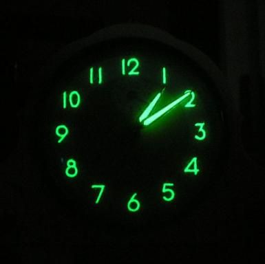 These Radioactive Elements Actually Do Glow in the Dark: This is a glowing radium painted dial from the 1950s. Radium doesn't really glow, but it emits radiation that causes phosphorescence in doped zinc sulfide.