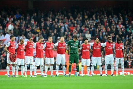 The Arsenal football team observe a minute's silence for Remembrance Day