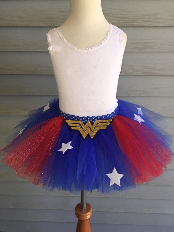 This Wonder Woman tutu is made of soft tulle on a comfortable elastic band featuring a removable Wonder Woman insignia. *Note the red tulle in this is