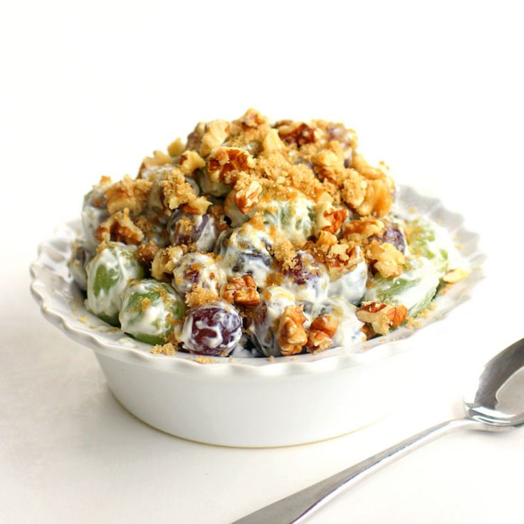 Grape Walnut Salad  2  lbs green seedless grapes  1  (8 ounce) package cream cheese, softened  1  cup sour cream  1/2  cup white sugar  1  teaspoon vanilla  1  cup chopped walnuts or pecans  1/2  cup brown sugar