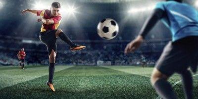 A footballer scoring a goal