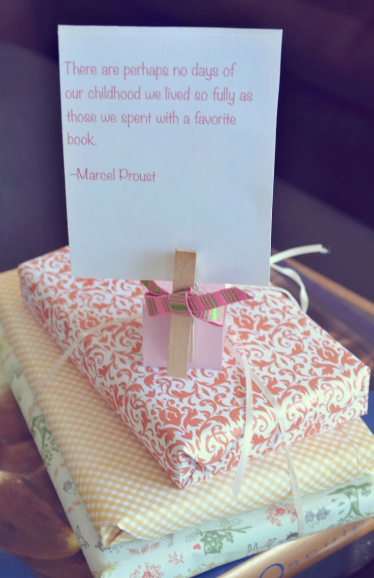 Baby Showers Reading ~ Reading quote on a centerpiece of wrapped books cute for