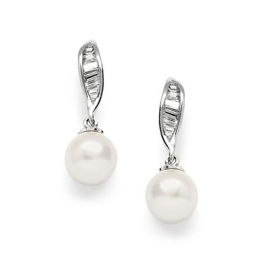 These beautiful earrings feature dainty baguette cubic zirconia and elegant man-made light ivory pearl drops.  Plated in tarnish resistant rhodium.  Width 0.8 cm and Height 2.4 cm.