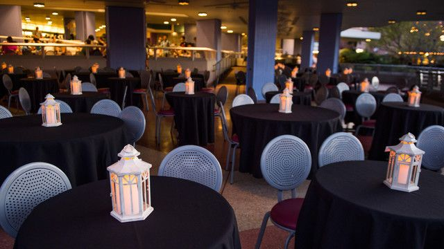 Lanterns glow atop tables at the Wishes Fireworks Dessert Party at Tomorrowland Terrace Restaurant