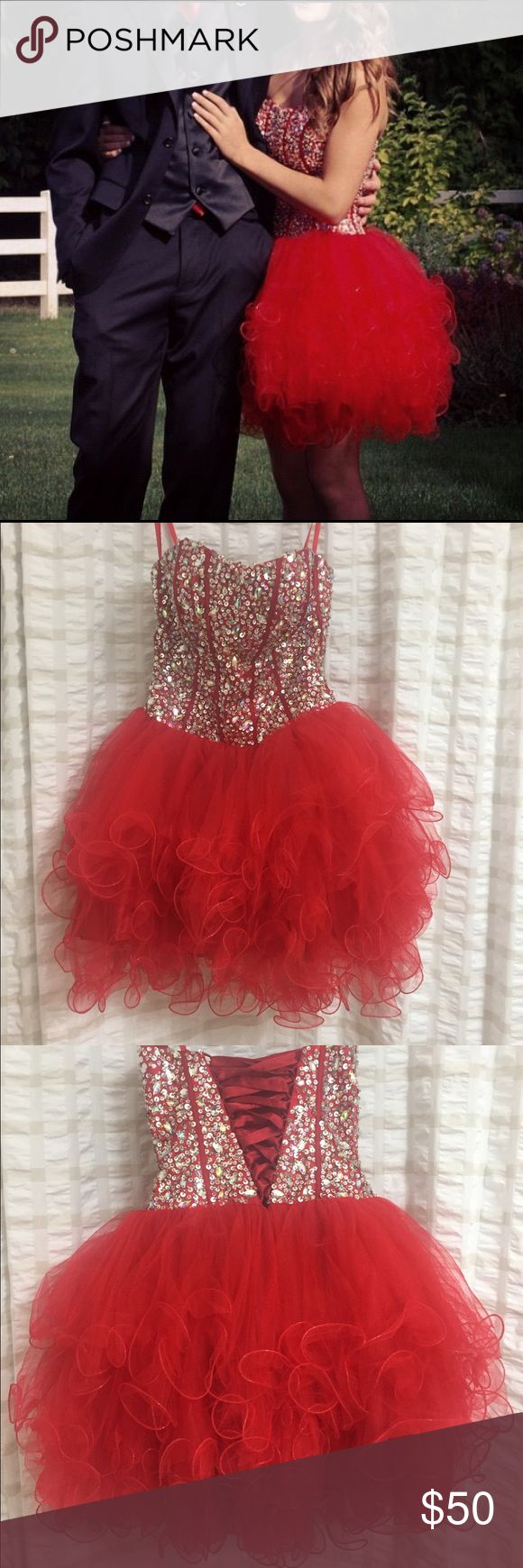Homecoming/Prom Dress PLEASE READ: Red short strapless homecoming/prom dress. Size S. Worn once for homecoming 2014. Lots of sparkles. Comes with red shawl that came with dress when bought, hanger, and plastic wrapping. Dresses Prom