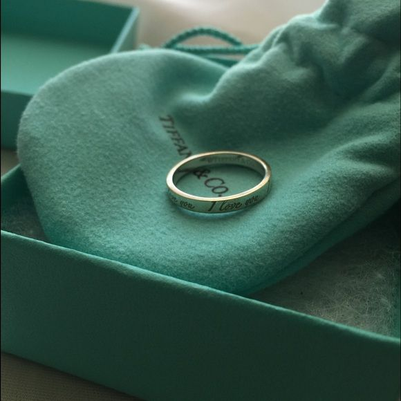 """Tiffany & Co """"I love you"""" ring Excellent condition, no scratches only worn a few times. My initials are engraved on the inside which you can get removed from a jeweler and Tiffanys can resize. I'm a seven and it fits fine. Willing to take offers on the price so use the offer button and no trades, thank you  will send the dust bag and box with it. Tiffany & Co. Jewelry Rings"""
