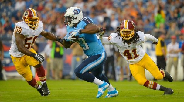 Titans running back Shonn Greene (23), center, gains ground on Redskins linebacker London Fletcher (59), left, and strong safety Phillip Thomas (41).