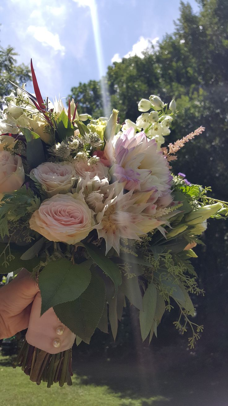 Two beautiful bouquets from our Keswick Vineyard wedding this past weekend! #gardenroses #dahlias #lisianthus #blushingbrideprotea #astilbe