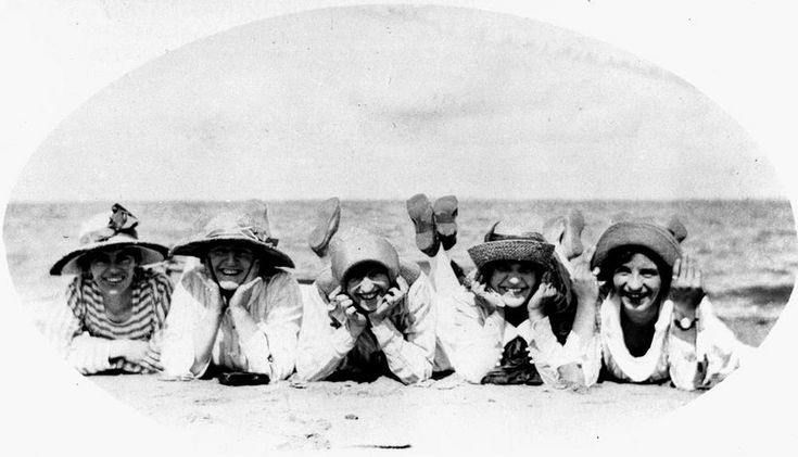 Five young women pose on the beach at Woody Point, Redcliffe, 1919